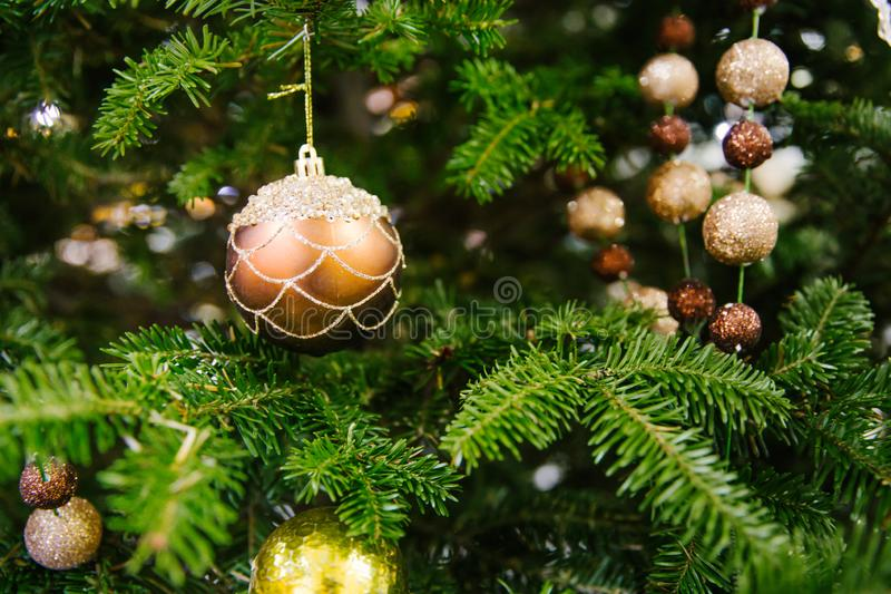 Close up of bauble hanging on the Christmas tree with other decorative toys. royalty free stock photos