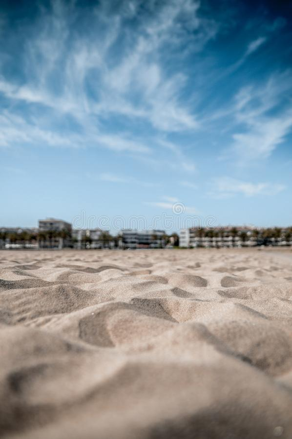 Beach sand with narrow depht of field. With the focus on the near sand and the sky in the background stock image