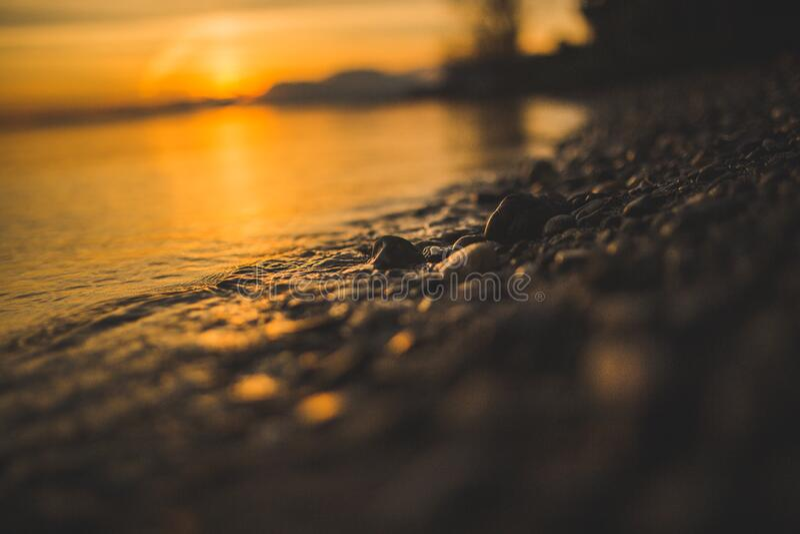 Close up of beach at sunset stock image