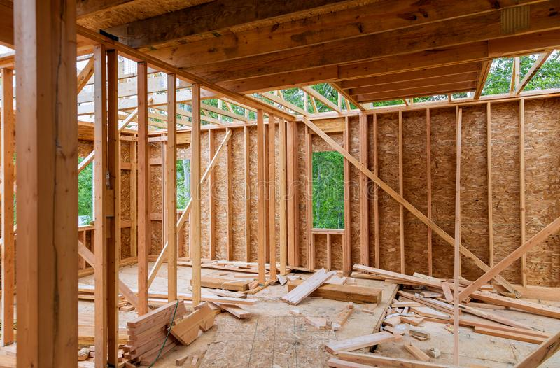 Close-up of beam built home under construction and blue sky with wooden truss, post and beam framework. Timber frame house, real. Close-up of beam built home stock photography
