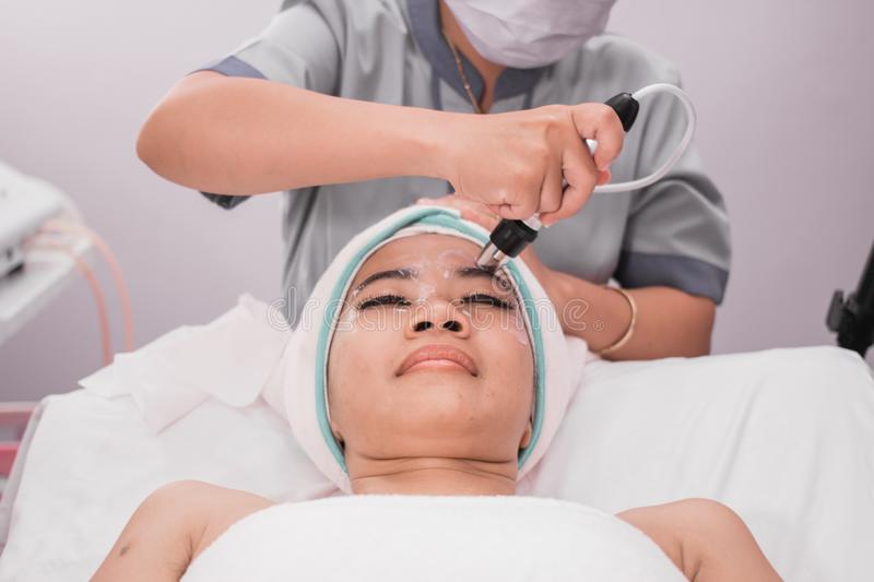 Beauty treatment using radio frequency equipment royalty free stock photo