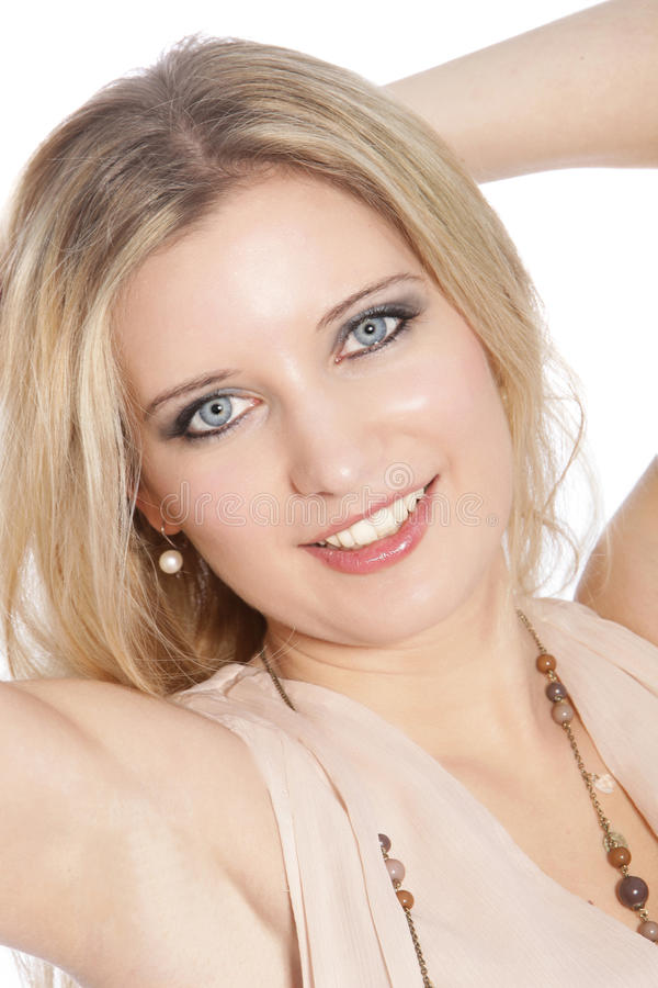 Close up of a beautiful blond haired woman smiling royalty free stock images