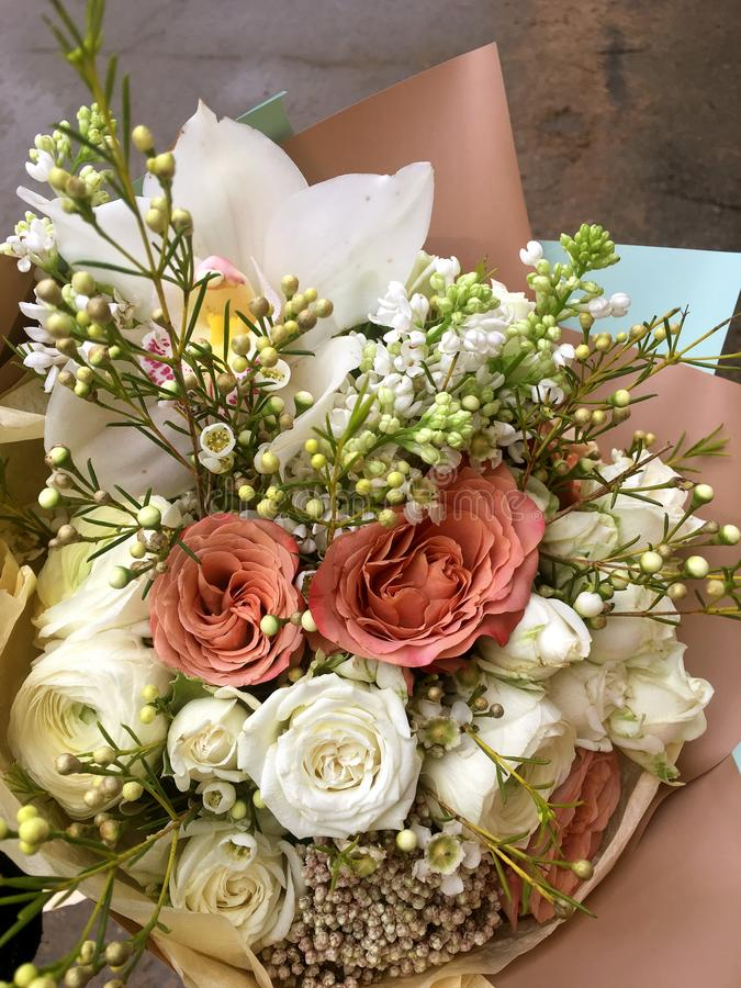 Spring bouquet of mixed colorful flowers. Flowers bouquet including white orchid Cymbidium , white Eustoma, white spray rose, royalty free stock images