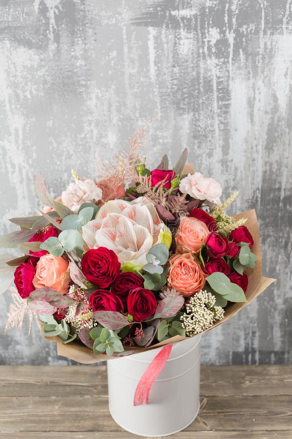 Close-up Beautiful Bouquet. Spring flowers on gray background. flower shop. Wooden table. Vertical photo. Close-up Beautiful Bouquet. Spring flowers in the cold stock photos