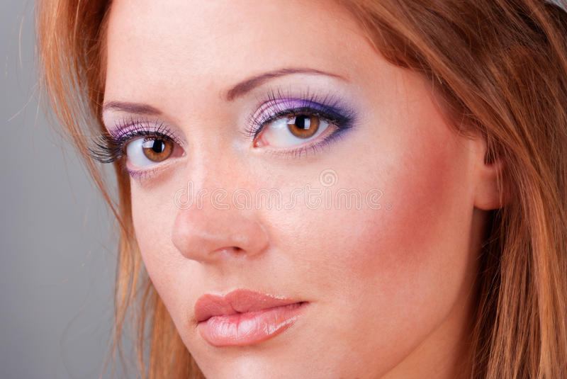 Close-up of the beautiful brown-haired lady. stock photo