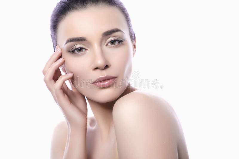 Close up of a beautiful brunette caucasian woman with fresh clean natural skin and soft smile on her face. Neutral, daily make up stock photos