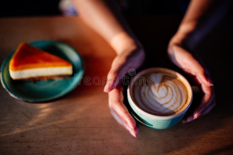 Cup of cappuccino in hands. stock images