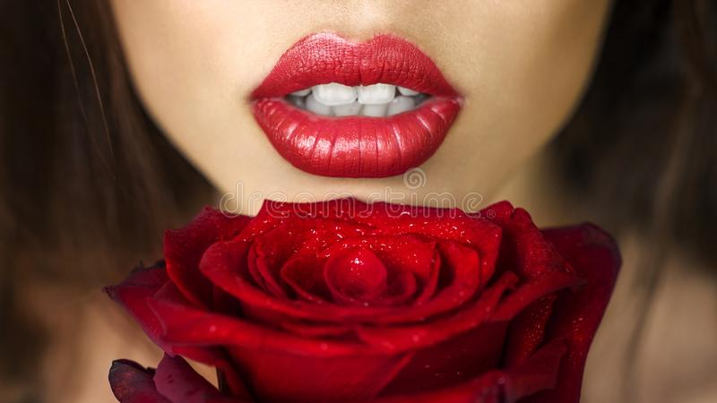 Close-up beautiful female lips with bright red makeup. Perfect clean skin, lip make-up. Beautiful spa portrait with royalty free stock photo