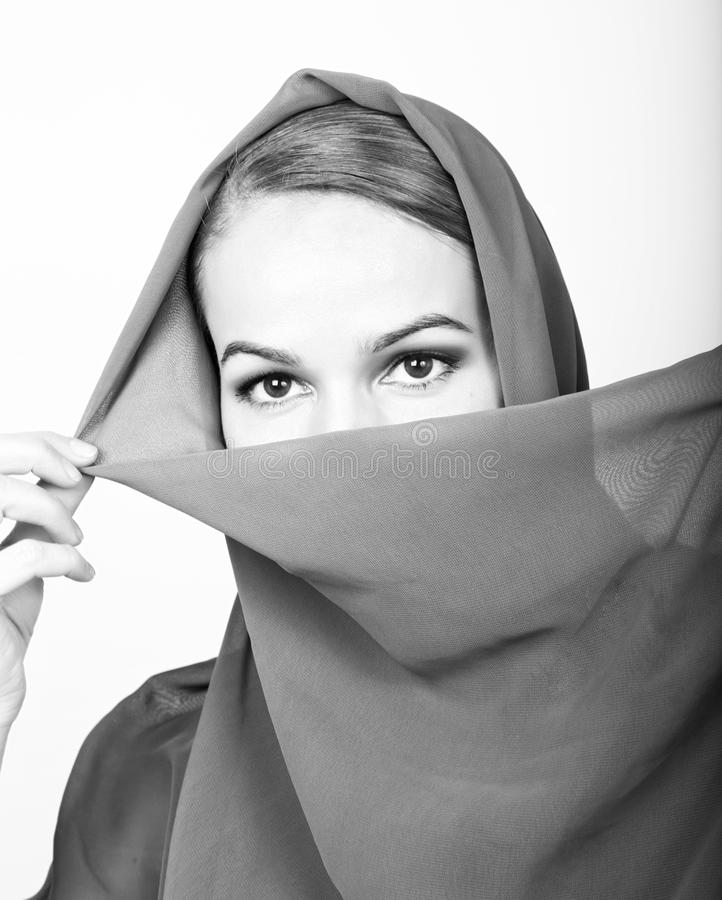 Close-up beautiful mysterious eyes eastern woman wearing a hijab.  stock image