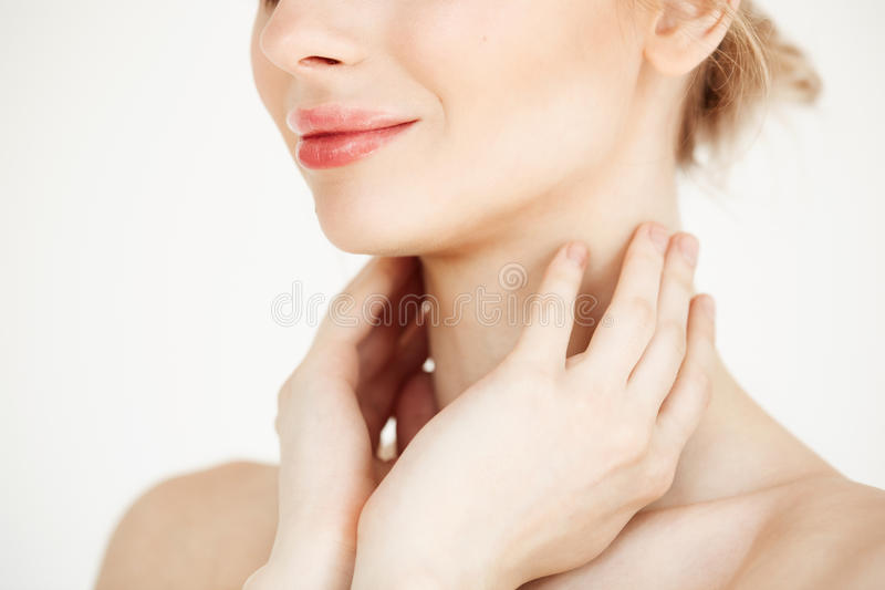 Close up of beautiful tender girl with clean healthy skin smiling over white background. Facial treatment. Close up photo of beautiful tender girl with clean stock photos