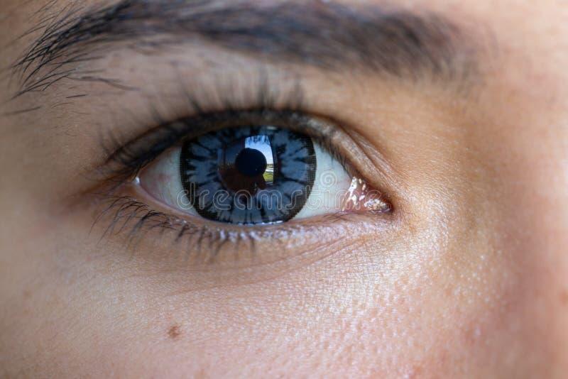 Close up of beautiful woman eye contact lens. stock photo
