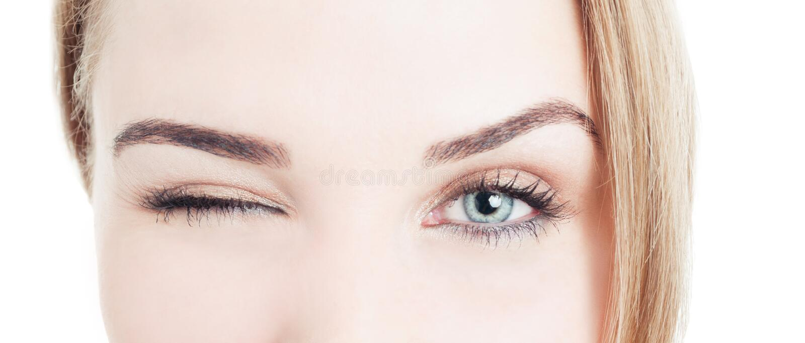 Close-up with beautiful woman eyes and wink stock images