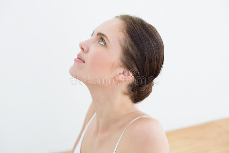 Close up of a beautiful woman looking up royalty free stock image