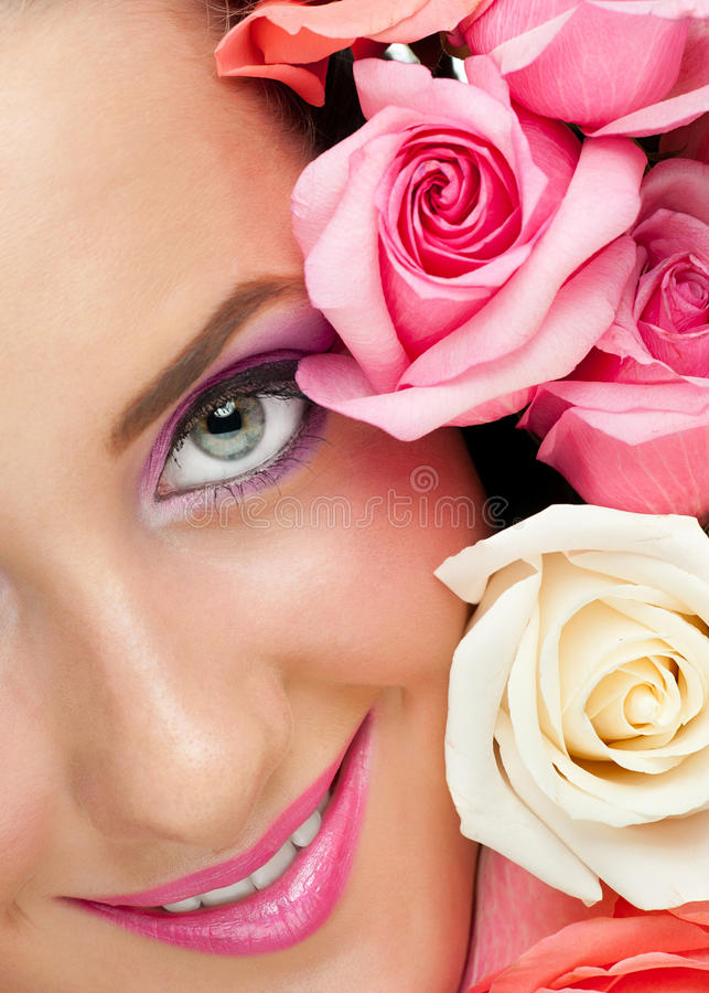 Close-up of beautiful woman with roses royalty free stock images
