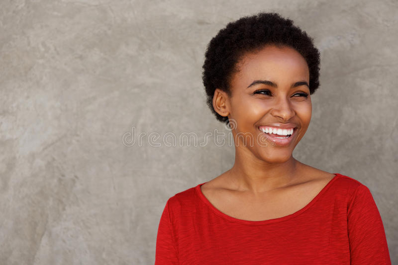 Close up beautiful young black woman laughing stock photos