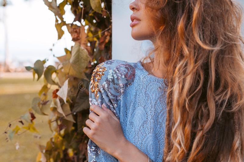 Close up of beautiful young fashion model in elegant dress at sunset at resort stock images