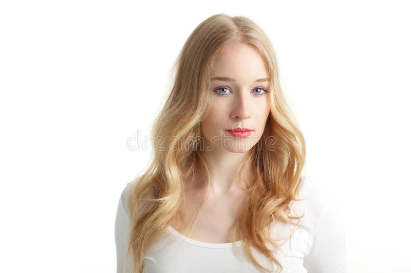 Close-up of a beautiful young woman smiling on white background stock photography