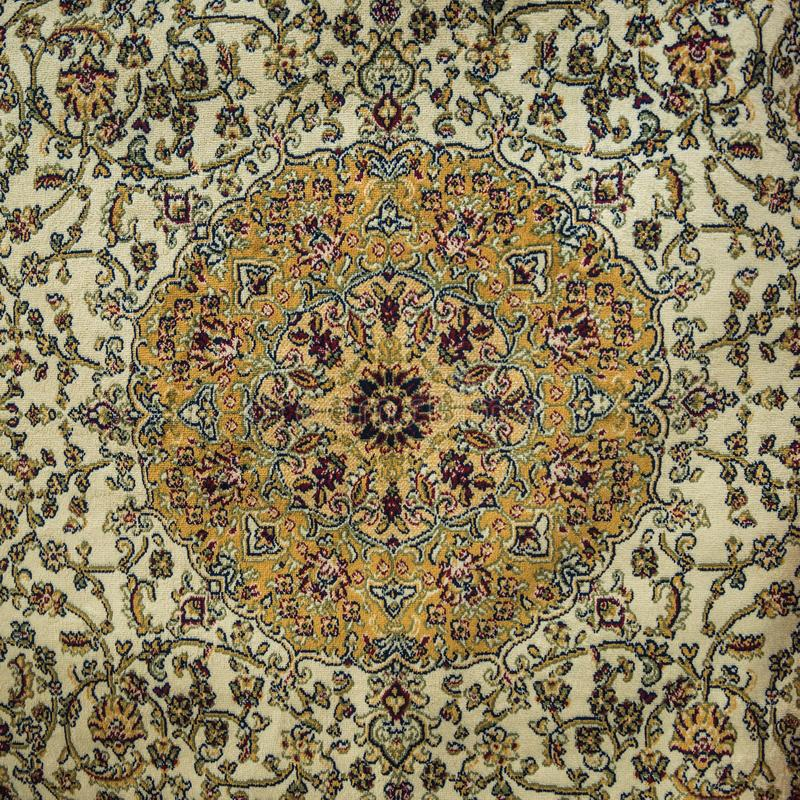 An intricate carpet design. Close up of a beautifully hand-woven Middle eastern carpet design royalty free stock images