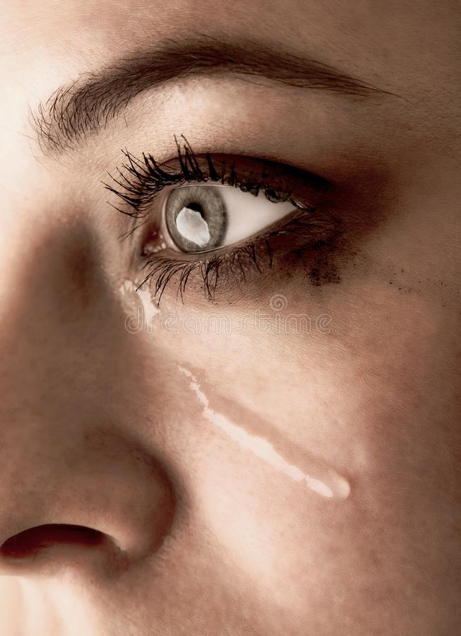 Close up of beauty girl cry. Woman with tear on face.  royalty free stock photos