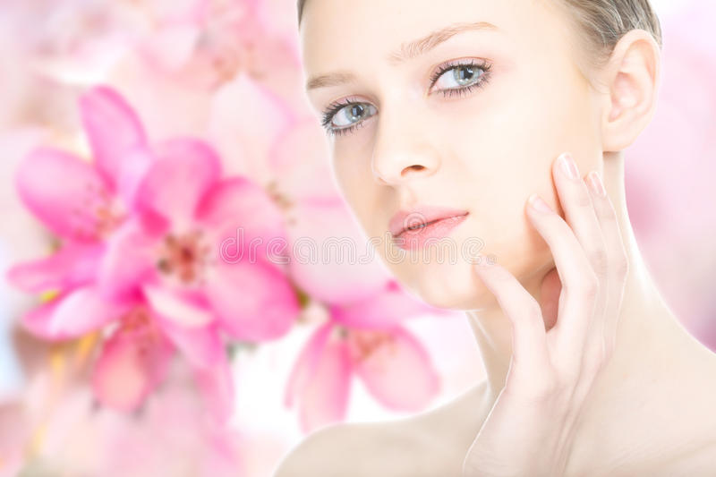 Close-up beauty girl portrait. On flower background stock images