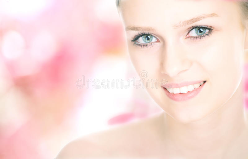 Close-up beauty girl portrait. On flower background royalty free stock photos