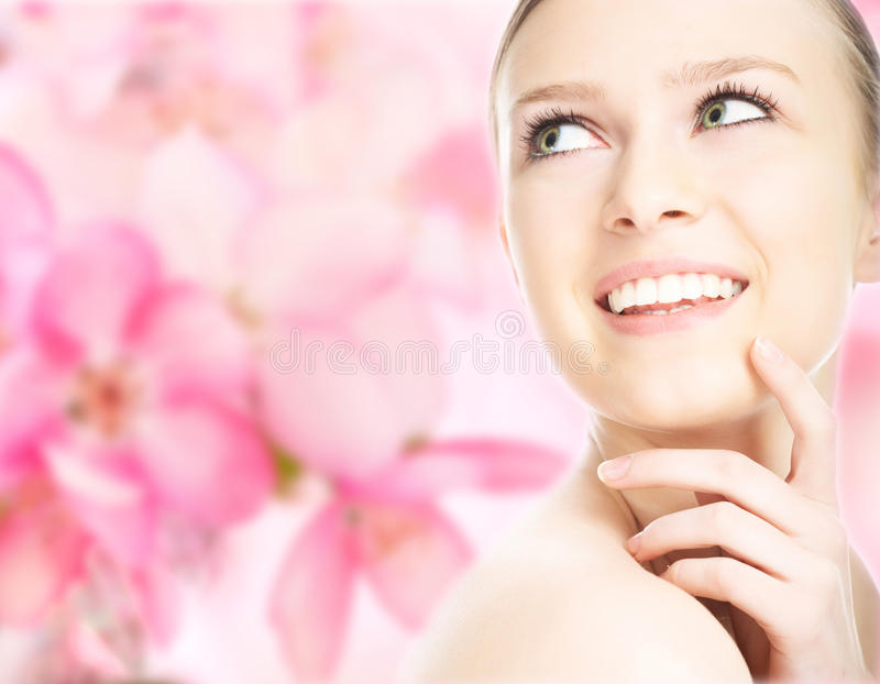 Close-up beauty girl portrait. On flower background royalty free stock image