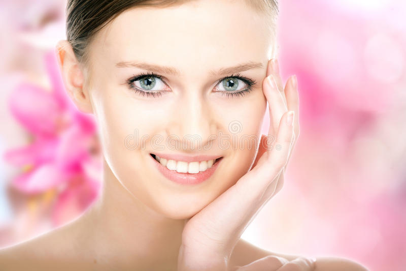 Close-up beauty girl portrait. On flower background royalty free stock photo