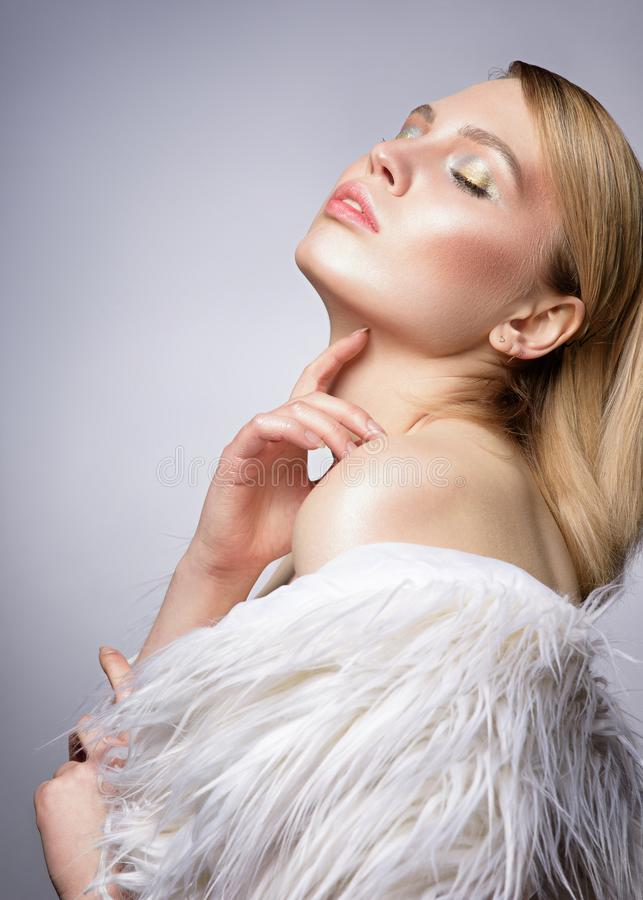 Close up beauty portrait of a pretty young blonde woman stock image