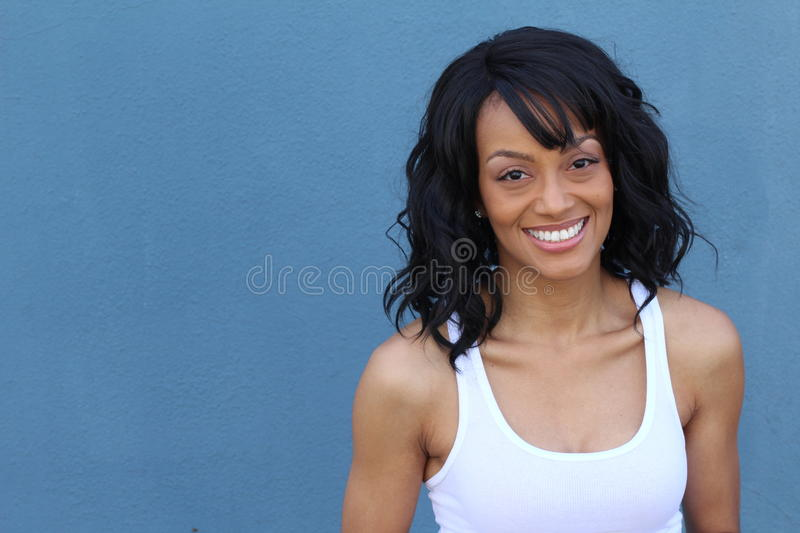 Close up beauty portrait of a young and attractive African American black woman with perfect skin, softly smiling stock photography
