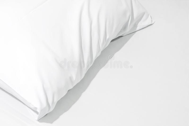 Close up of bedding sheets with copy space,White pillow on the b. Ed with blanket royalty free stock photo