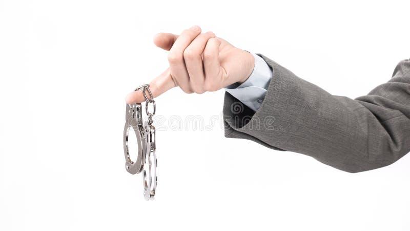 close-up bedrijfsmensen die handcuffs houden verantwoordelijkheid voor misdaden stock foto's