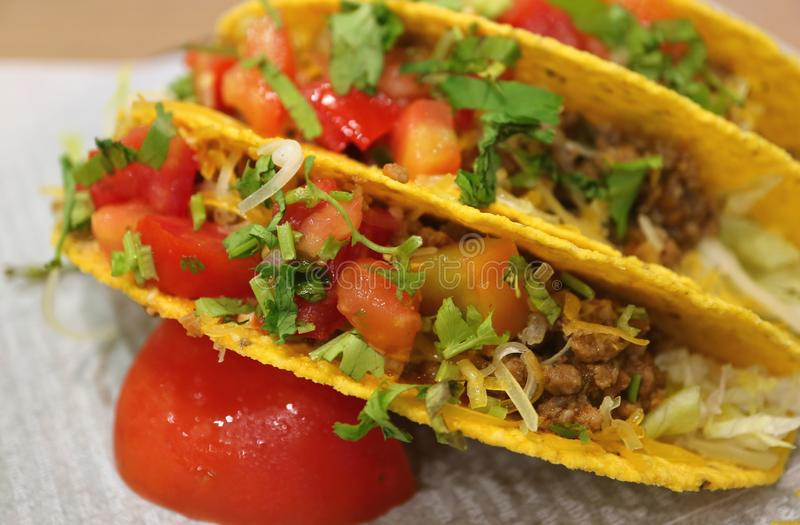 Close up of beef tacos with salsa sauce, tasty Mexican fast food stock photography