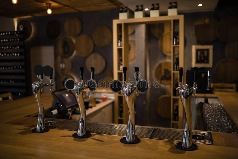 Close-up of beer pump at counter royalty free stock image