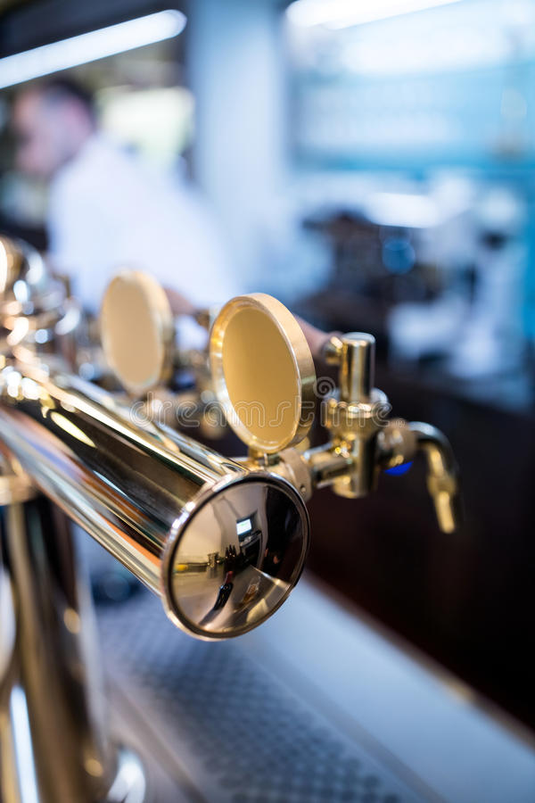 Close-up of beer pump in a row stock photo
