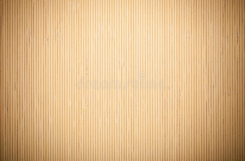 Close up beige brown bamboo mat striped background texture pattern. Close up macro of beige brown bamboo mat as striped background texture pattern. Oriental royalty free stock photo