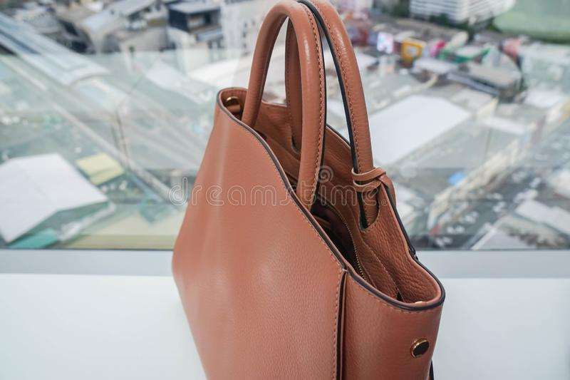 Beige luxury leather women bag for going to work. Close up beige luxury leather women bag for going to work stock images