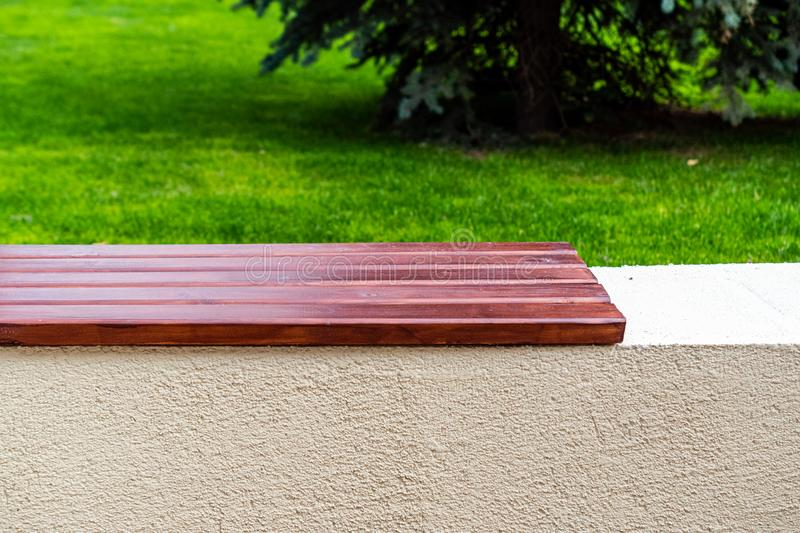 Close-up of the bench. City bench made of wood on a cement base. Space for lettering or design stock photo
