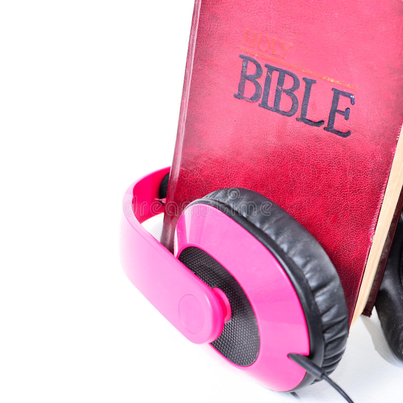 Close up Bible and headphone. Close up Bible and headphone on white background stock photography