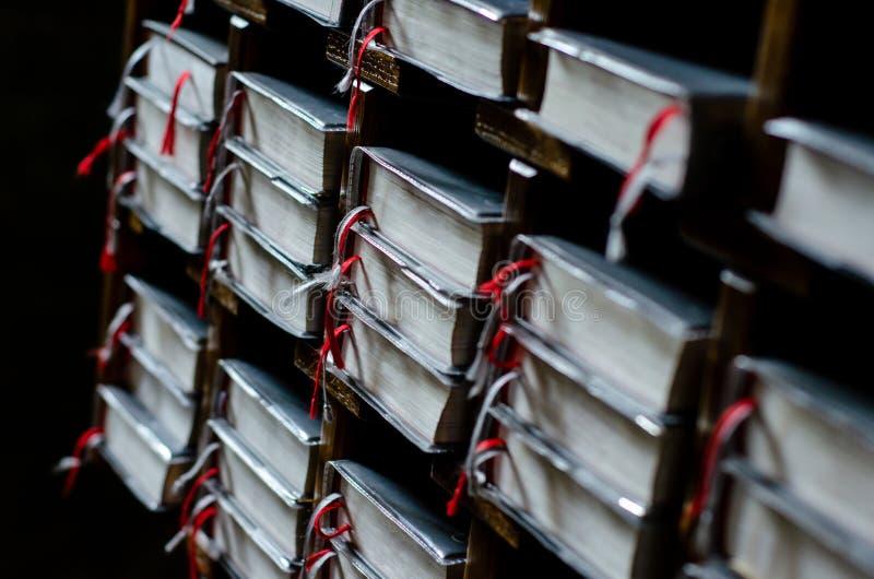 Close-up of Bibles In Book Shelf stock photos