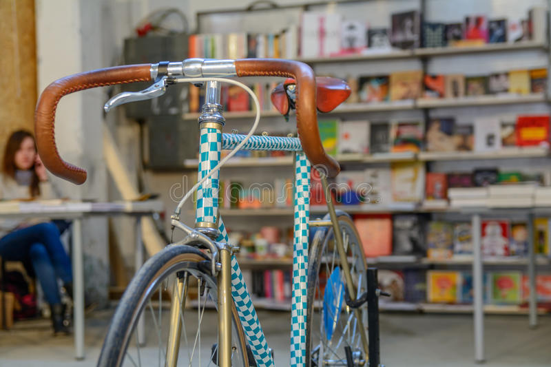 Close-up with bicycle in bookstore. De focused/ blur image of a stock image