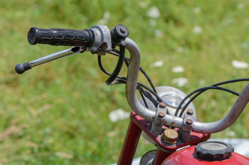 Close-up with bicycle handle. Detail of vintage bicycle handlebar with rust.. stock photo