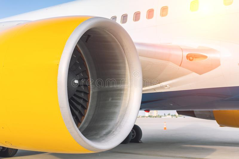 Close-up big commercial plane engine standing on airfiled after aircraft arrival on bright sunny day. Airplane, transportation, jet, technology, turbine royalty free stock images