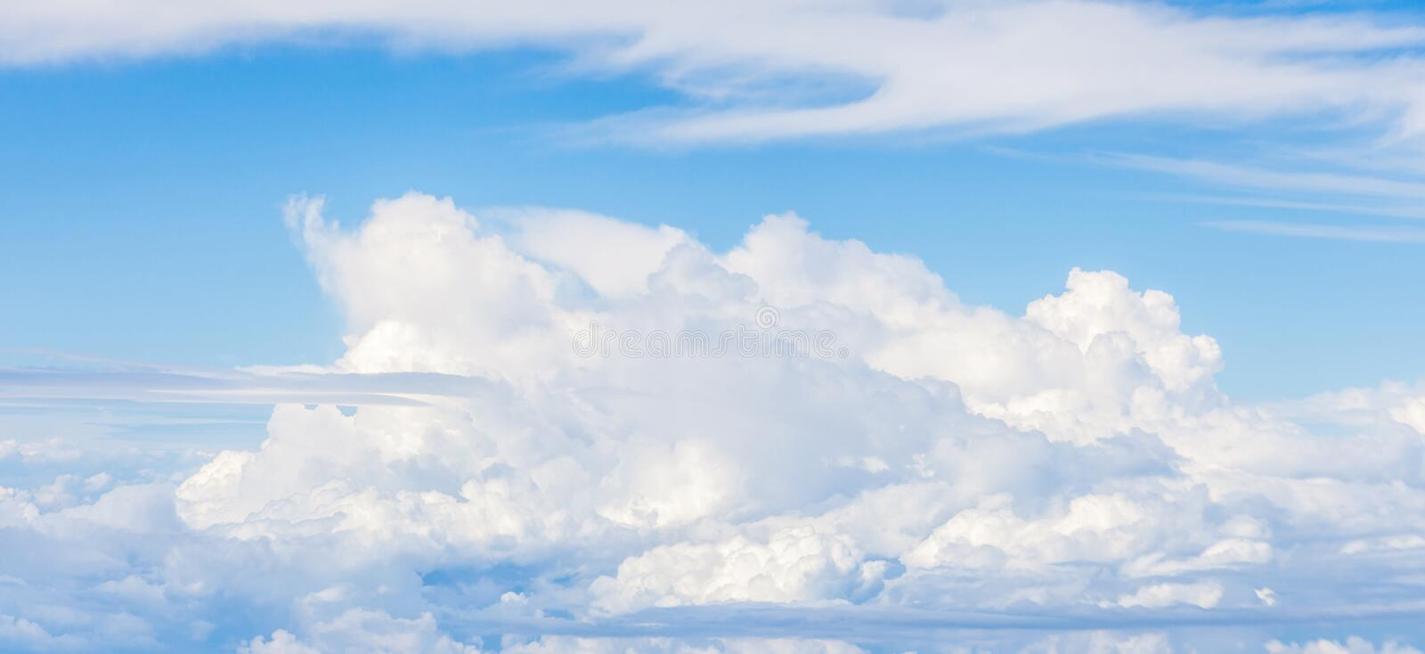 Close-up big fluffy clouds in light blue sky, beautiful cloudscape. royalty free stock images