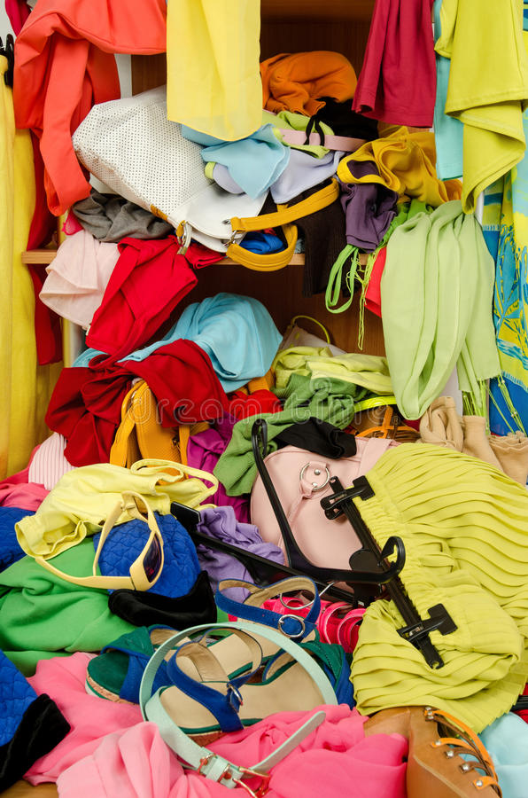 Close up on a big pile of clothes and accessories thrown on the ground. stock photos