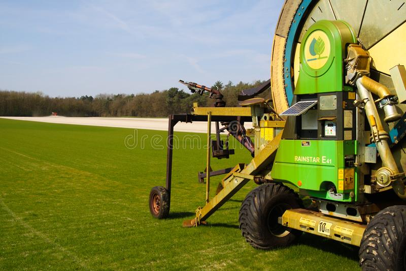 ROERMOND, NETHERLANDS - MARCH 30. 2019: Close up of big sprinkler for agricultural irrigation on green lawn stock images