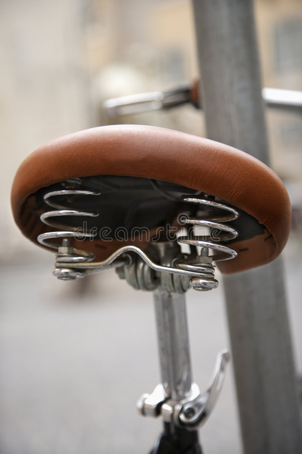 Close-up of bike seat in. stock photos