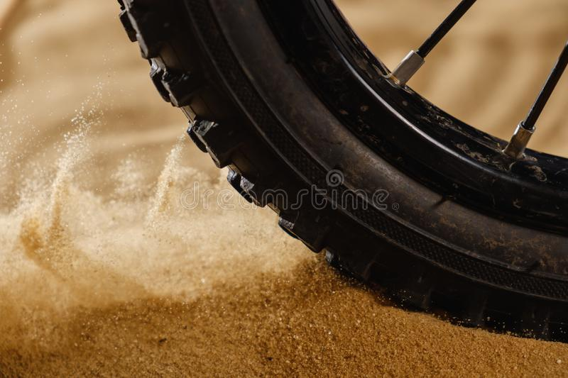 Close up bike tire shot on the beach . Outdoors, nautical, biking, urban living, cross fitness and adventure. Background concept royalty free stock photo