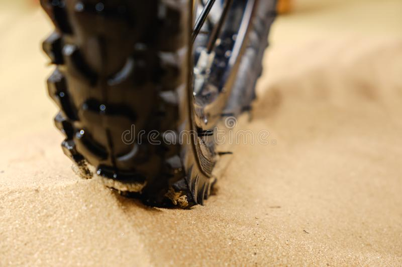 Close up bike tire shot on the beach . Outdoors, nautical, biking, urban living, cross fitness and adventure. Background concept royalty free stock image