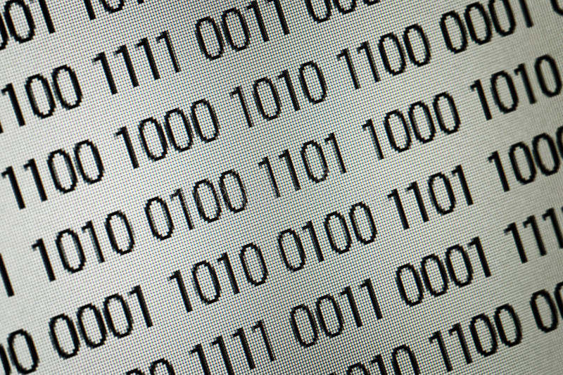 Close up of binary code. Over white background royalty free stock image