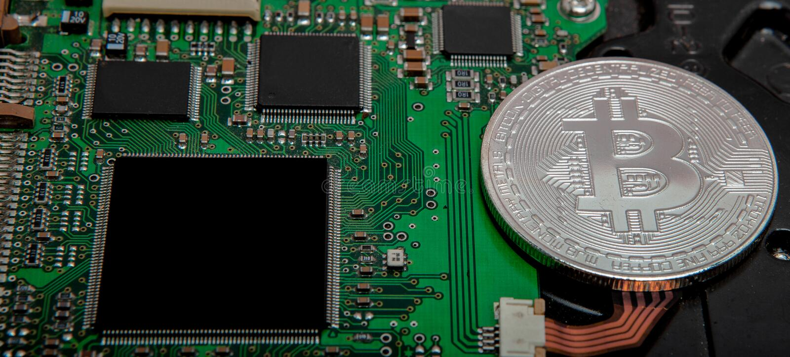 Close-up of bitcoin, computer circuit board with bitcoin processor and microchips. Electronic currency, internet finance rypto cur. Rency. Bitcoin mining royalty free stock photos